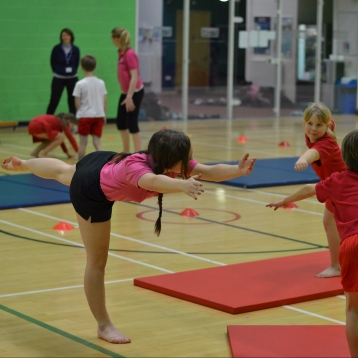 The superman arabesque at a gymnastics event for local primary schools